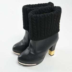 Leather heeled boots with Gold details
